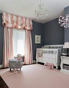 Grey and pink for a baby girl? I THINK SO! Those curtains are horrid though. -Mia