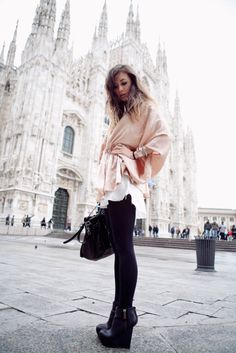 Clever use of a large scarf draped and belted - this is amazing with that cathedral in the background!