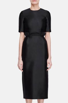 """""""I wanted to create a brand that reflects a slower pace and process,"""" says designer Gabriela Hearst, """"where things are made with care and detail."""" Her approach is demonstrated by this refined dress from the resort 2017 collection. Made in Italy of a lustrous blend of silk and wool, it gains a ruffled flourish from the paperbag waist. Finishing touches include on-seam side pockets, a concealed back zipper, and a back vent."""