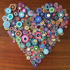 A special Bull's Eye Studio style Happy. Paper Quilling Patterns, Quilling Paper Craft, Polymer Clay Projects, Polymer Clay Beads, Old Magazine Crafts, Recycled Paper Crafts, Rolled Paper Art, Bottle Cap Art, Clay Design