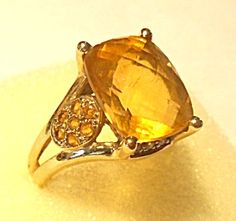 $599 Cushion Cut Vintage 14k Gold Honey Citrine & Diamond Ring 7, Spectacular ring! Large center Citrine gemstone is set high, 7 small citrines on each side and Diamond accents in front & back. A perfect Honey Citrine color.