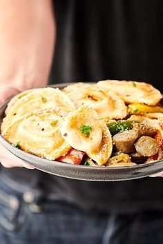 Sheet Pan Pierogies with Sausage and Peppers. Garlic and parmesan pierogies baked until crispy with beer brats, peppers, and onions! A quick and easy family dinner that is sure to be a crowd favorite! Lunch Recipes, Gourmet Recipes, Dinner Recipes, Soup Recipes, Recipies, Sausage And Peppers, Stuffed Peppers, Mousse, Easy Family Dinners