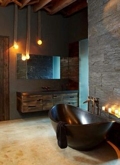 Contemporary industrial? Very cool bath, vanity, lighting and walls.