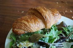 Spring salad mix with freshly grated mozzarella and a buttery croissant, straight out of the oven.