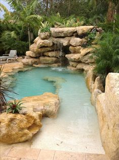 Sand entrance to our newest natural stone tropical pool. - Sand entrance to our newest natural stone tropical pool. Tropical Pool Landscaping, Backyard Pool Designs, Backyard Landscaping, Landscaping Design, Backyard Ideas, Garden Ideas, Tropical Backyard, Tropical Gardens, Backyard Patio