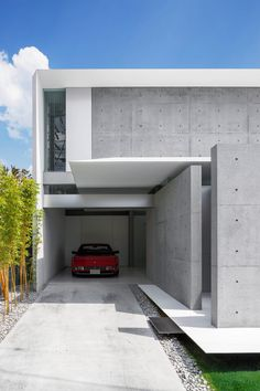 Three L-shaped structural sections with wafer-thin edges wrap around concrete external walls and glazed internal partitions at this house in Shunan.