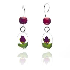 "Aretes Óvalo Chico Transparentes con Rosas Naturales Encapsuladas. T.A.M.I. ""Joyería que florece en ti."""