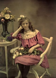 Autochrome, not tinted, c1910-1915.  Girl with a pink dress and flowers