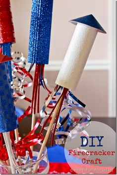 DIY Firecracker Paper Centerpiece!  How cute would this be on your 4th of July Table?!  #4thofjuly #patriotic #centerpiece