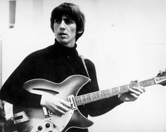 Guitarist George Harrison of the rock and roll band The Beatles records on a Rickenbacker electric guitar in the studio in circa 1965. (Photo by Michael Ochs Archives/Getty Images)