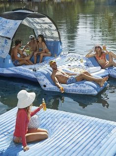 Generously sized and loaded with everything you need for a fun day on the water, this deluxe party island is the ultimate lake house accessory.