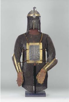 """""""AN INDIAN CARVED AND GOLD DAMASCENED STEEL SUIT OF ARMOUR, NORTH INDIA, LATE 18TH CENTURY"""