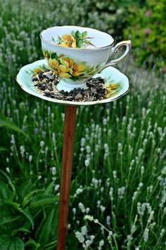 Teacup Birdfeeder - think how pretty some of these would be among your flowers....if the copper pipe is expensive, maybe substitute a PVC cap and use a dowel rod for the pole? Paint to match your teacup...cute idea! This site has instructions....