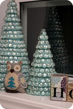 Dollar Store DIY Christmas Tree Decor! What you will need: Styrofoam cones, Craft paint Brush (optional, you can leave white also) Glue gun, Glue sticks Glass bowl fillers (Ones that are flat on bottom). The process is so simple. Paint the styrofoam (optional), let dry, glue on the glass. Pretty and Shiny!