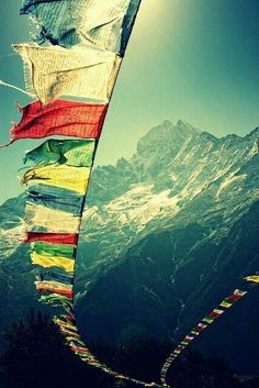 This is a picture of Tibet. It shows the scenery of Tibet with the religious flags and the snow mountains. I really like this picture because it expresses the spirit of Tibet.