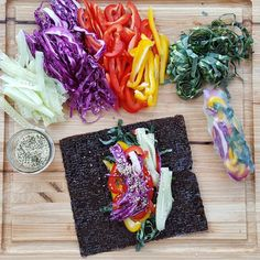Dinner. Simple. Vibrant.   1. slice what's in the fridge (cucumbers, collards, bell pepper, red  cabbage) 2. add protein (hemp seed or chopped almonds for me, flaky fish in the  Mr.'s) 3. lay it out on rice paper wraps, nori seaweed wraps, or even sturdy green  like a collard leaf   Make a dip like my Chipotle Dressing or use bottled sweet 'n sour dipping  sauce. Boom. Done.  I've added leftover chicken, fish, tempeh...use what you have. Enjoy!  What's on your plate?   Featured Feb 13…