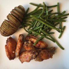 Sesame maple chicken wings with garlicky green beans and a roasted accordion potato. #foodie #cleaneating #bonappetit