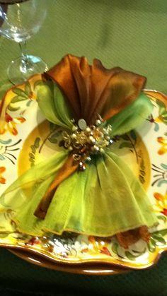 Lovely holiday color combination & beautifully display of an elegant napkin fold.