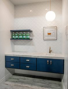 Call me old fashioned... but we love this mini bar. Consider mixing a rustic faux wood tile with a bright white tile for contrast.