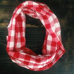 When you slip this infinity scarf around your neck, you'll make the boys blush- but you can even wear it to church.  This circle scarf is the perfect accessory for any adventure. Features a light/medium weight  fabric in large red and white gingham check plaid- perfect for year-round wear. handcrafted in Nashville, TN One size. Limited run. www.nytonashville.com