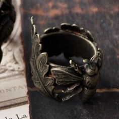 A bee-ring by Lotta Djossou, creator of a whole, wonderful line of art deco/folk-esque rings, necklaces and other stuff. The Dandy chose the bee.