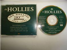At £4.98  http://www.ebay.co.uk/itm/Hollies-The-Woman-Love-CD-Pre-Release-Single-CDEM-264-1993-/251151467425