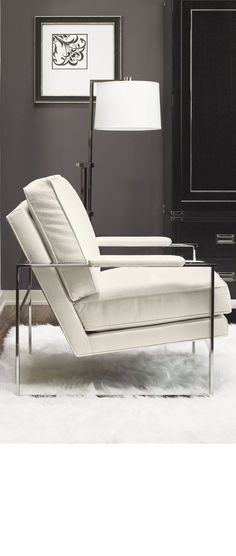 Stylish cream leather and chrome armchair to complement  dark grey living room walls.