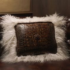 """Handcrafted with rich Tuscany chocolate crocodile leather and dreamy vanilla Tibetan lamb. Embellished with genuine Swarovski crystals and concho. Genuine Leather. 14"""" x 16""""."""