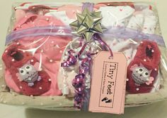 Gifts for a baby girl and new mum beautifully assembled in a Mother & Baby Girl Hamper from www.tinyfeethampers.co.uk Deliver UK wide #babygift #babygirl #baby