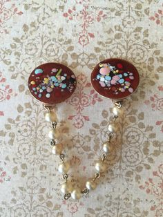 A personal favorite from my Etsy shop https://www.etsy.com/listing/469935828/exquisite-vintage-confetti-enamel-pearl