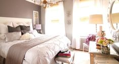girl's rooms - West Elm Pin-Tuck Duvet gray walls white nailhead trim headboard white shams silver metallic pillow ivory shag pillow black pillows nailhead trim bench mirrored cabinet chest sunburst mirror white sheers layered bamboo roman shades