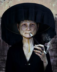 Hakka Woman. I wonder what she's smokin