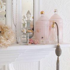 Romantic bedroom. Chanel perfume bottles