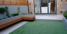 modern garden designer london artificial grass hardwood seat fireplace hardwood…