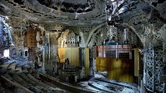Detroit in ruins. The ruined Spanish-Gothic interior of the United Artists Theater in Detroit. The cinema was built in 1928 by C Howard Crane, and finally closed in Photograph: Yves Marchand and Romain Meffre Abandoned Buildings, Abandoned Mansions, Old Buildings, Abandoned Places, Abandoned Library, Derelict Places, Detroit Ruins, Abandoned Detroit, Architecture