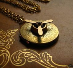 Off Etsy, Amelia Earhart Locket - vintage locket, propeller charm