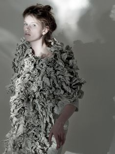 Fashion design duo Sabine Egler  Miriam Lehle of Prose, produced the Crumpled Paper Story collection of textural knits and printed fabrics inspired by folded and creased surfaces; close up crumpled paper coat.