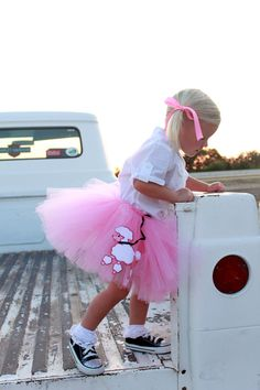 This has got to be the most adorable little girl in the back seat of a truck, wearing a poodle skirt tutu - picture I've ever seen! @atutudes #tutu #dreamersintodoers #doeroftheweek