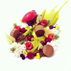 Chocolate ganache, pistachio, white chocolate crémeux, raspberry sorbet, chocolate streusal, and dulcey powder by @bachour1234 #TheArtOfPlating