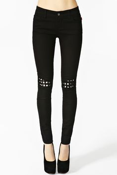 Ripped Stud Skinny Jeans