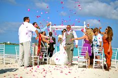 The colors in this Bahamas destination wedding are fantastic. That pink against the blue sky is to die for.
