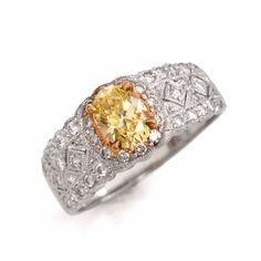This diamond engagement ring is a gorgeous beauty to behold, sparkling with illumination and romantic details! Finely crafted in solid platinum, it is centered with 1 genuine oval fancy intense yellow diamond approx. Yellow Diamond Engagement Ring, Platinum Engagement Rings, Antique Engagement Rings, Sparkle, Fancy, Jewelry, Jewlery, Jewerly, Schmuck