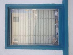 Shells in a window. Newport Beach CA. May 2013