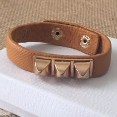 New T&J faux leather stud bracelet Brand New Retail item from T&J designs, this is a beautiful piece it's camel color it has two snap closures adjustments. T&J Designs Jewelry Bracelets