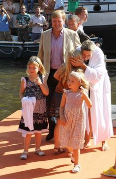 Princess Máxima is greeted by her family after her charity swim for ALS, in a Amsterdam canal.