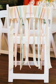 Hung pastel ribbons make this chair look oh so sweet! {Riverland Studios}