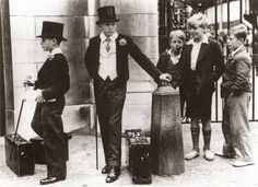 """This photo has become famous since it was published in 1937 with the headline """"Every picture tells a story."""" The photo shows two upper-class British youths standing on the left, while three boys who had ditched school for the day stand on the right."""