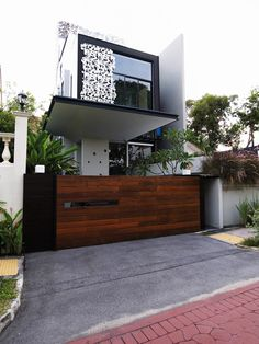 Modern wooden gates with stainless steel frame hard wood for Wooden front gate designs