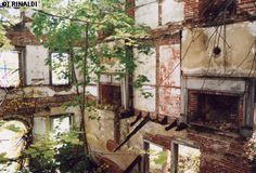 The shell of an abandoned row house near the Hudson River in Milton, NY