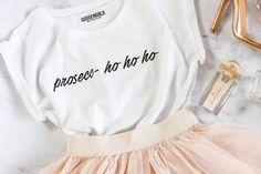 Fan van prosecco en op zoek naar dé outfit voor aan het kerstdiner? Dan hebben wij misschien wel het perfecte shirt voor jou gevonden. Prosecc-ho-ho!